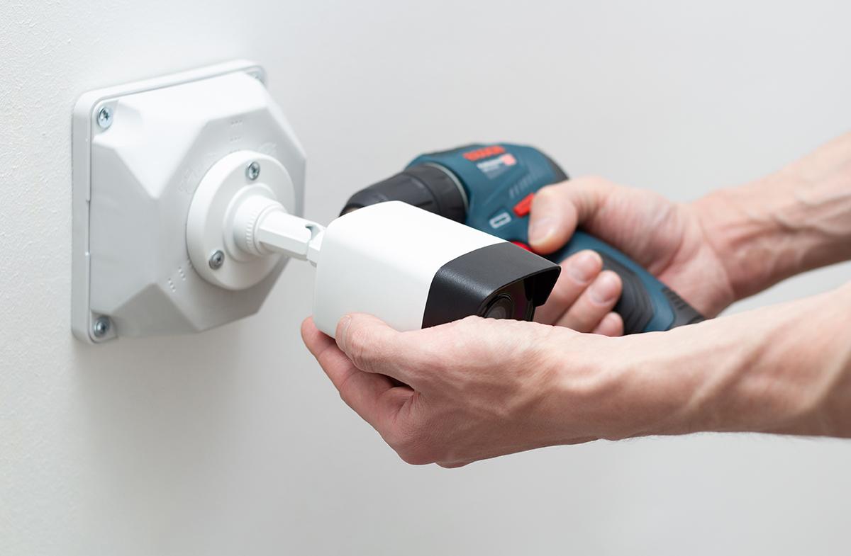 techician installing cctv camera
