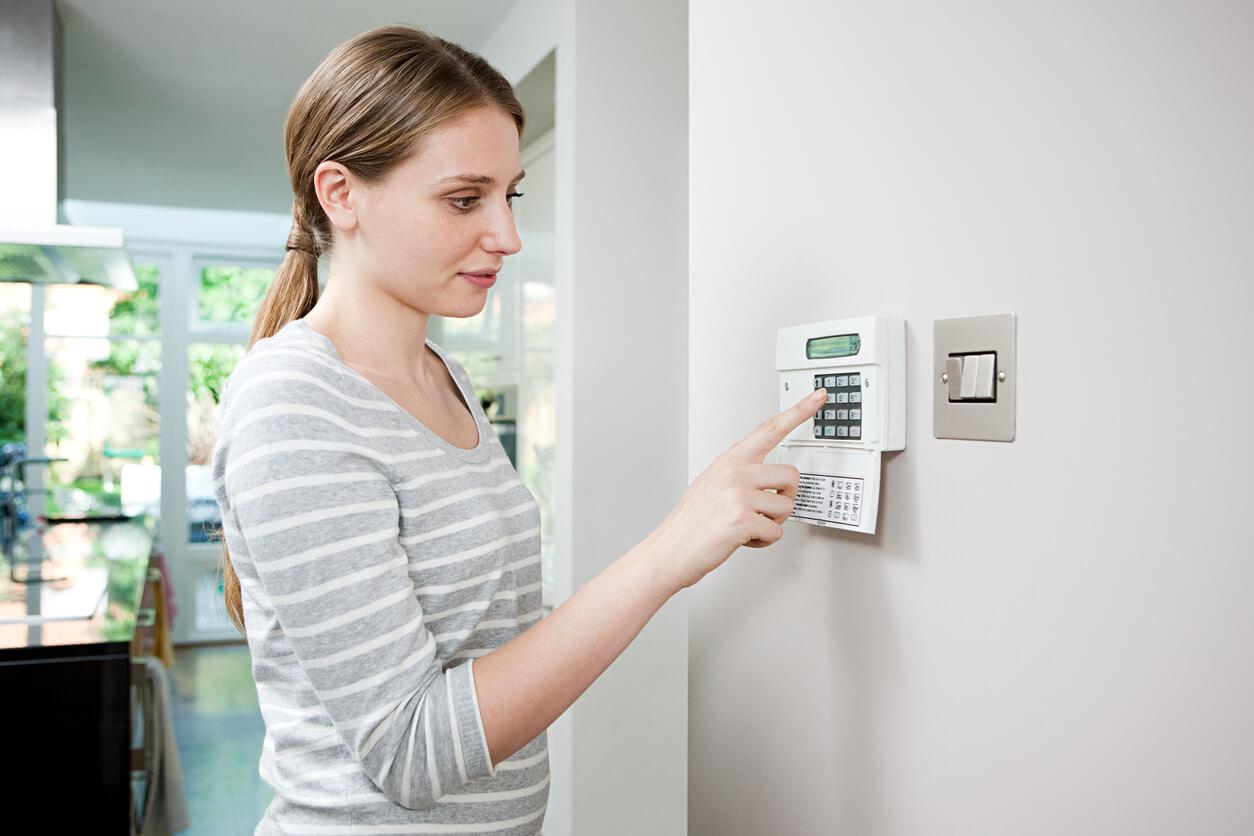 women setting burglar alarm